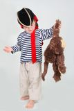 Child dressed as pirate with monkey Stock Images