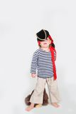 Child dressed as pirate with monkey Royalty Free Stock Images