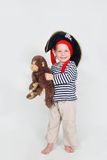 Child dressed as pirate with monkey Royalty Free Stock Photo