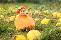 Child dressed as a pumpkin for Halloween. Little girl as a pumpkin for Halloween royalty free stock photo