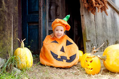 Child dressed as a pumpkin for Halloween. Little girl as a pumpkin for Halloween stock photography