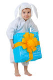 Child dressed as a rabbit with a gift box Royalty Free Stock Images