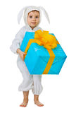 Child dressed as a rabbit with a jumbo gift Stock Images