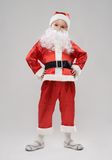 Child dressed as Santa Claus Stock Images