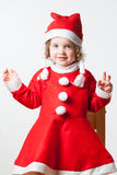 Child Dressed As Santa. A happy child with Christmas joy dressed as Santa Claus Stock Photography