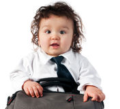 Child dressed in a business with a bag Royalty Free Stock Image