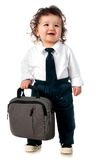 Child dressed in a business with a bag Royalty Free Stock Photography