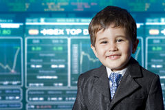 Child dressed businessman. stock market Royalty Free Stock Images