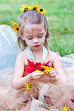 Child Dressed in Fairy Costume. A little woodland fairy gathering flowers Stock Photography