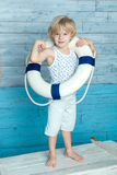 Child dressed lifeline. Child wearing a life preserver, and stands on the chest Royalty Free Stock Photography