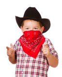 Child dressed up as cowboy playing Royalty Free Stock Images