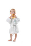 Child in a dressing gown. The child in a dressing gown on a white background Royalty Free Stock Photo