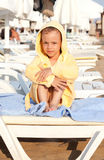 Child in a dressing gown on rug. Royalty Free Stock Photo