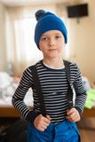 Child dressing for skiing. Stock Photography