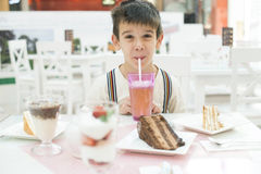 Child drink lemonade royalty free stock photo