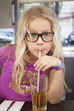 Child with drink and straw Stock Photography