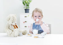 Child drink tea. With bagels at home royalty free stock image