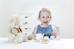 Child drink tea. With bagels at home royalty free stock images
