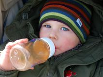 Child drinking Royalty Free Stock Image