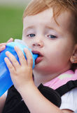 Child drinking Stock Images