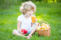 Child drinking apple juice Royalty Free Stock Photos