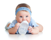 Child drinking from bottle. 8 months old girl. Royalty Free Stock Photo