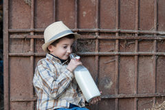Child drinking a bottle of fresh milk. Child is holding and drinking a bottle of fresh milk Royalty Free Stock Photography