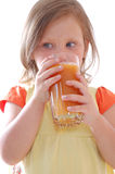 Child drinking carrot juice royalty free stock photos