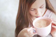 Child drinking cocoa Stock Photography