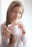 Child drinking cocoa Stock Photo