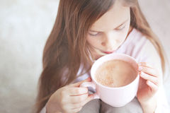 Child drinking cocoa Royalty Free Stock Image