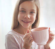 Child drinking cocoa Stock Image