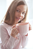 Child drinking cocoa Royalty Free Stock Photos