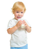 Child drinking dairy product from glass isolated Royalty Free Stock Photography