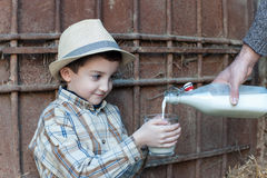 Child drinking a glass of fresh milk Stock Photos