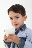Child drinking glass of milk. Handsome child drinking a glass of milk Royalty Free Stock Images