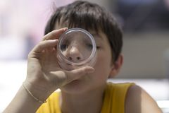 Child drinking a glass of pure water. Healthy concept royalty free stock photo