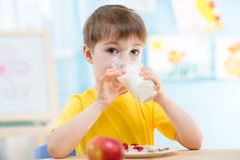 Child drinking healthy beverage at home Royalty Free Stock Photo