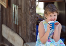 Child drinking hot drink Royalty Free Stock Image