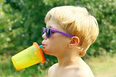 Child Drinking on Hot Summer Day Stock Images