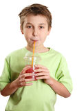 Child drinking a juice Royalty Free Stock Image