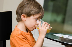 Child drinking juice Royalty Free Stock Image