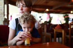 Child drinking juice Royalty Free Stock Image