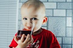 Child drinking juice royalty free stock photo