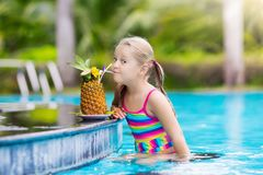 Child with pineapple juice in pool bar stock photography