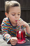 Child drinking lemonade Royalty Free Stock Photo