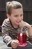 Child drinking lemonade Stock Images