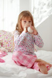 Child drinking milk in bed Royalty Free Stock Photo