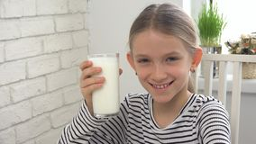 Child Drinking Milk at Breakfast in Kitchen, Girl Tasting Dairy Products stock images