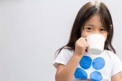 Child Drinking Milk / Child Drinking Milk Background / Child Drinking Milk Studio Isolated. Kid drinking milk on studio isolated white background royalty free stock image